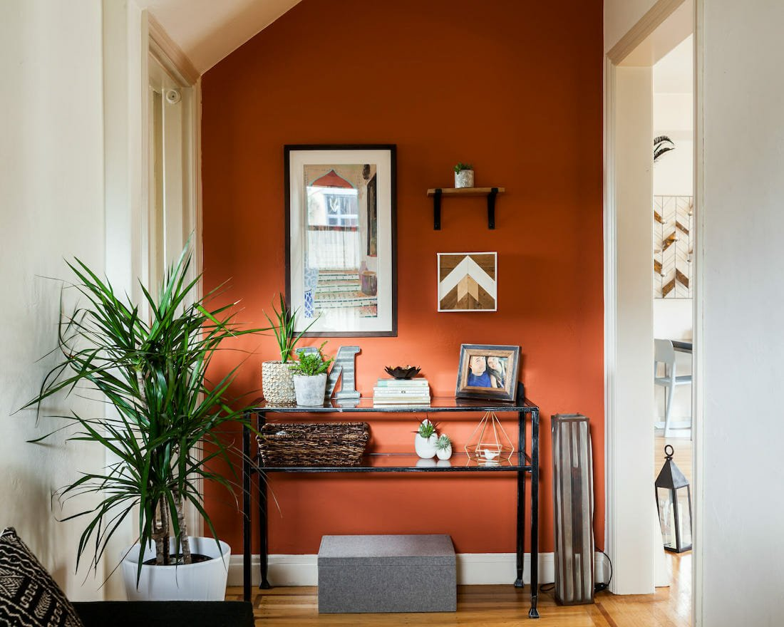 Bold entryway with Orange accent wall
