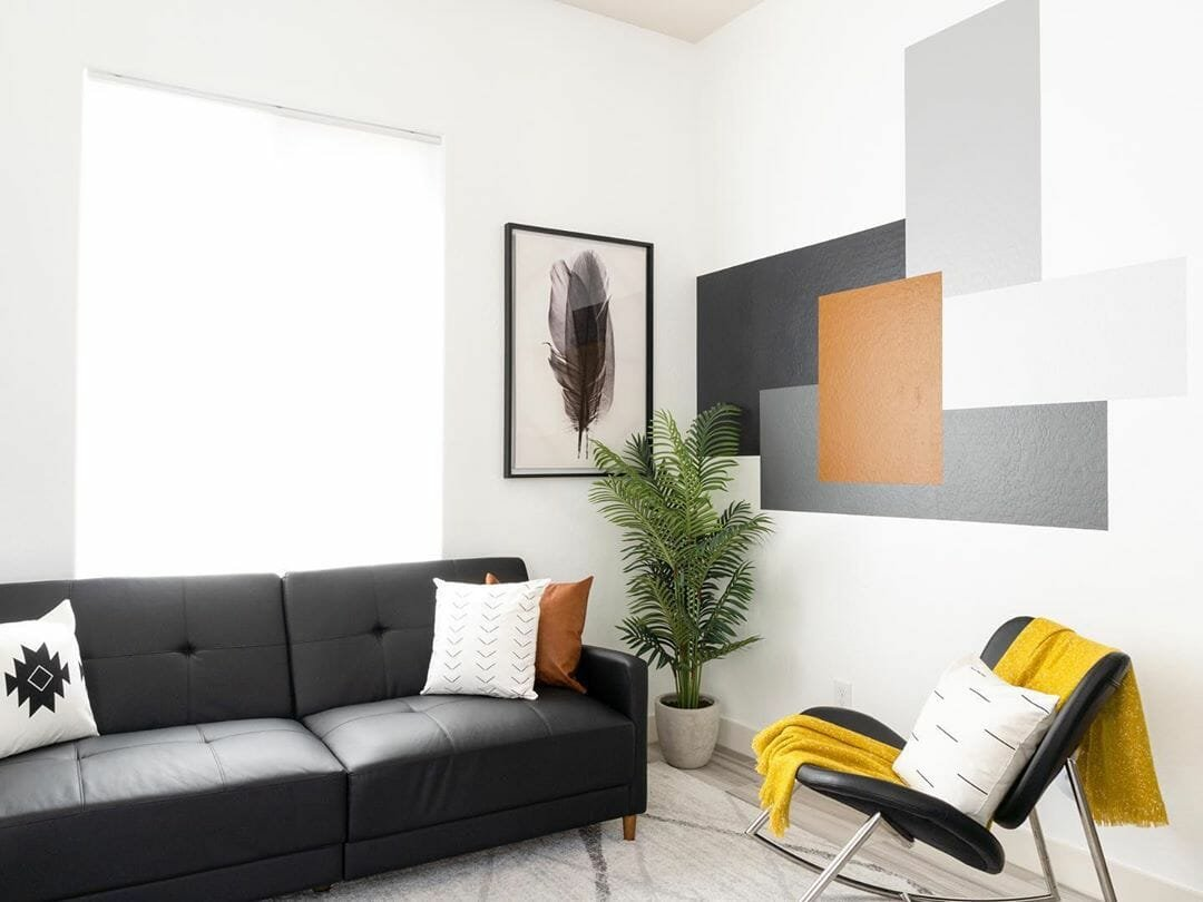 Grey accent wall as artwork in living room