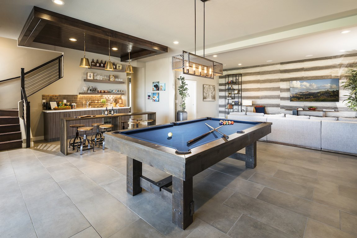 Modern in home bar with a pool table and lounge area