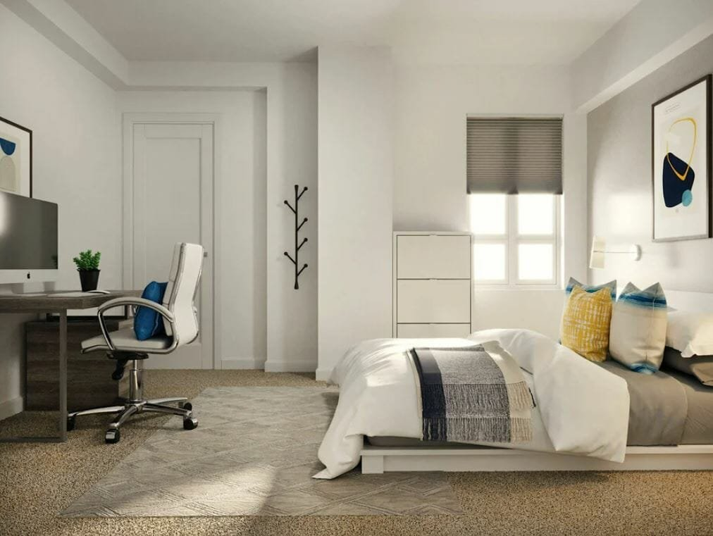 Modern masculine bedroom with a low bed and soft furnishings