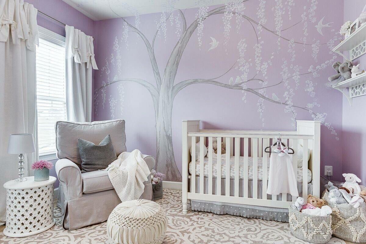 Nursery design in purple accent wall