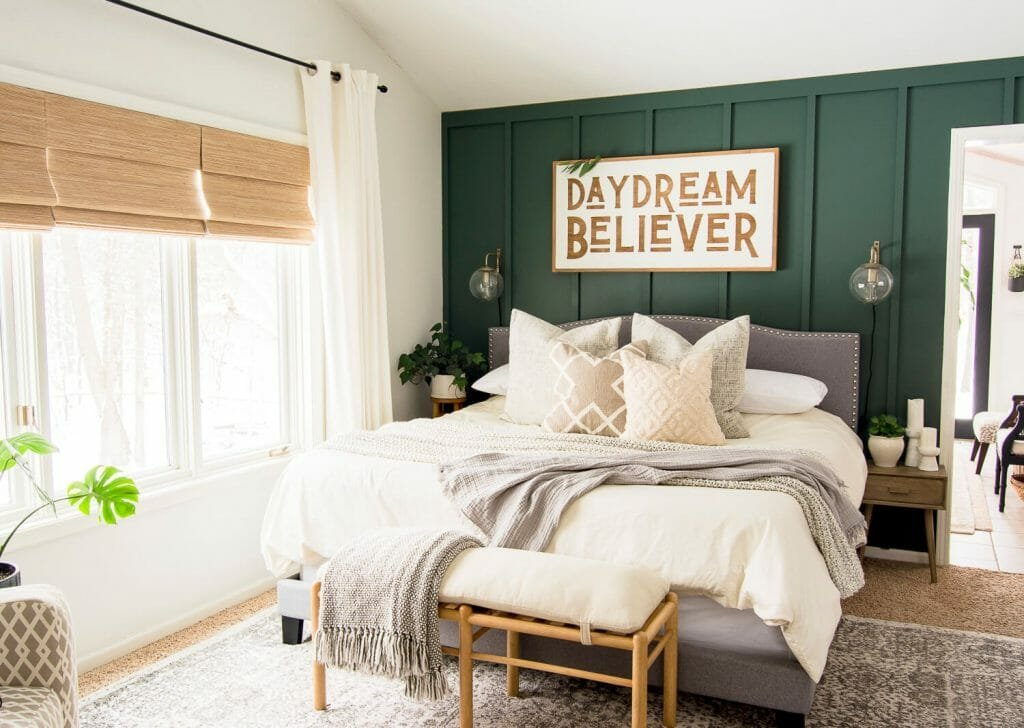 Sage green accent wall in bedroom design