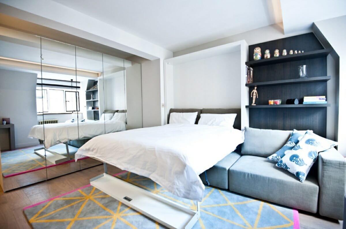 Studio apartment decor with mirrrored wardrobes