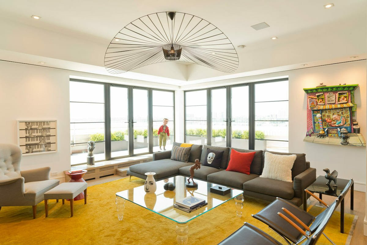 Bright yellow lounge with eclectic home decor - Susan W
