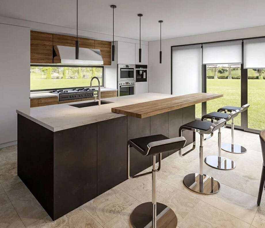 Contemporary kitchen addition with a view of the backyard