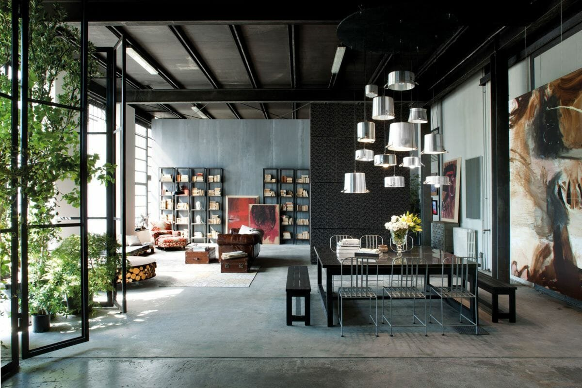 Large open concept interior filled with industrial decor and wall decor - homedit
