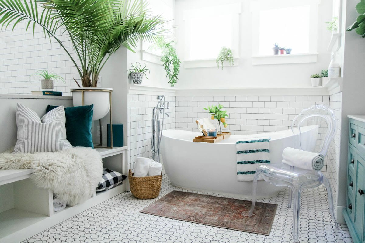 Lush coastal bathroom by one of the top raleigh interior designers casey h