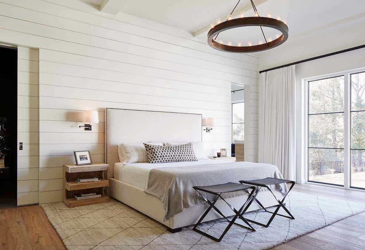modern farmhouse bedroom with painted beams
