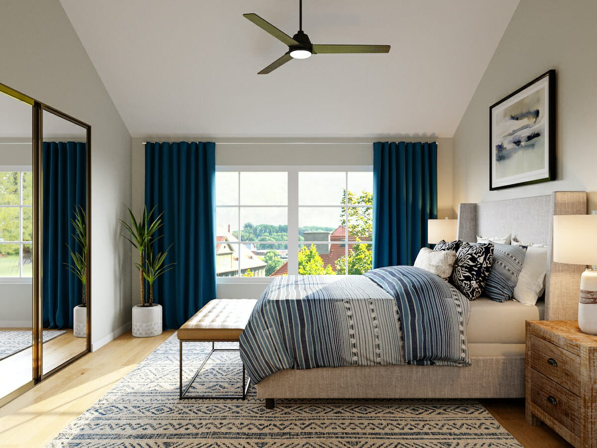 Blue accented transitional master bedroom by Casey Hardin