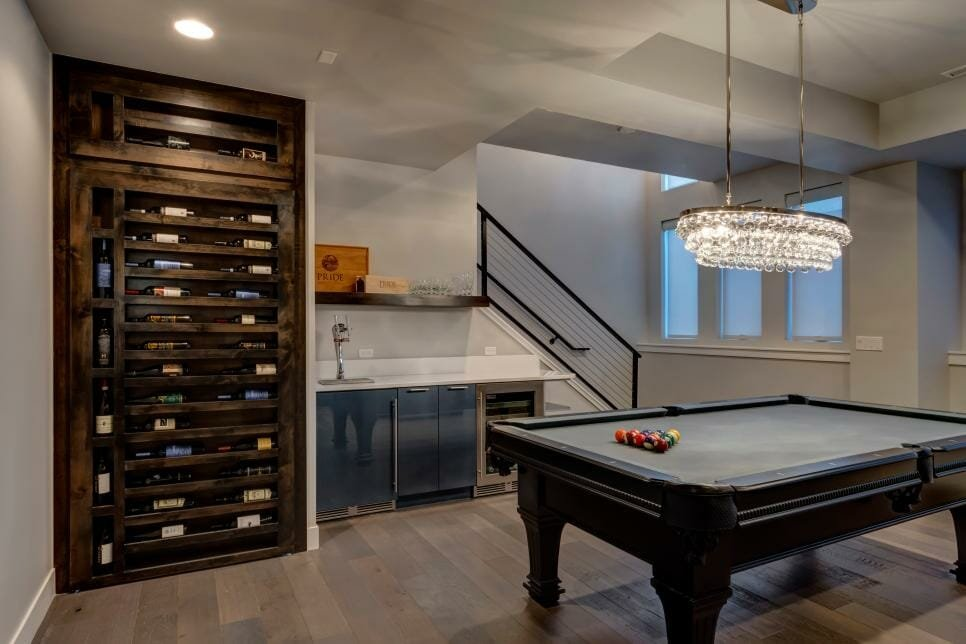 Basement designs with a bar and games area - HGTV