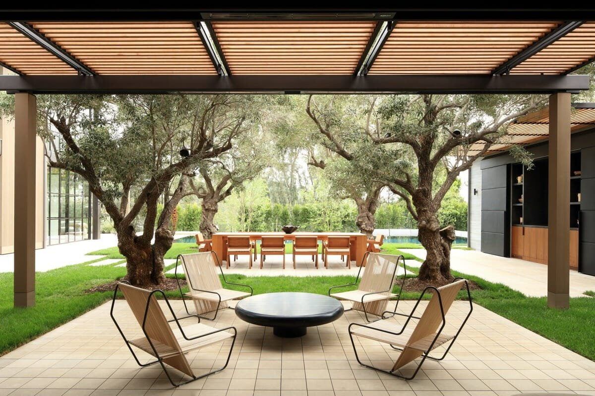 Modern pergola design with sleek outdoor furniture