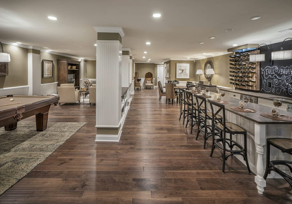 Traditional basement designs with a bar and pool table